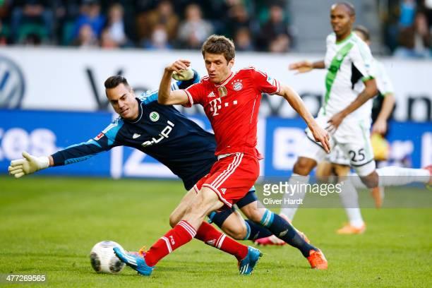 Thomas Mueller of Munich scoring their second goal during the Bundesliga match between VfL Wolfsburg and FC Bayern Muenchen at Volkswagen Arena on...