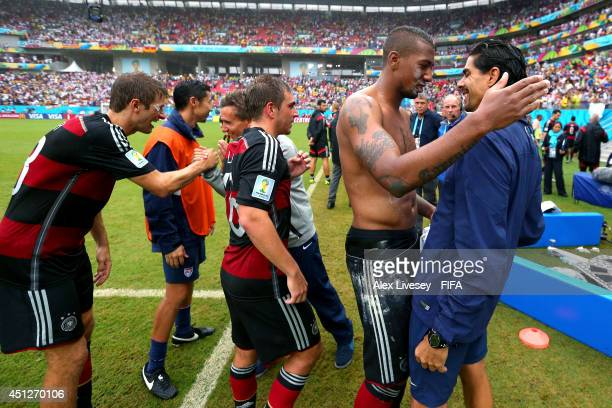 Thomas Mueller Philipp Lahm and Jerome Boateng of Germany celebrate with fitness coach Marcelo Martins after the 10 win after the 2014 FIFA World Cup...