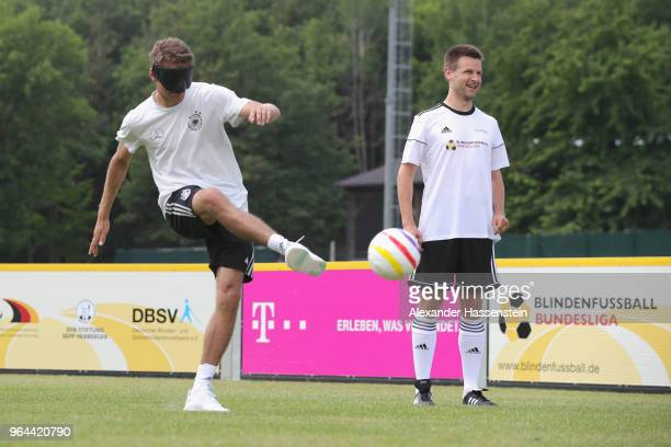 Thomas Mueller plays the ball during a Blind Football demonstration match with national players of the German national Blind Football team at...