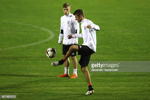 Thomas Mueller plays with the ball during a training session of the German national team at Stadio di Santamonica di Misano Adriatico on November 9...