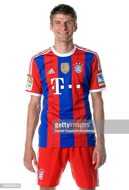 Thomas Mueller poses during the FC Bayern Muenchen Team Presentation for DFL on August 9 2014 in Munich Germany