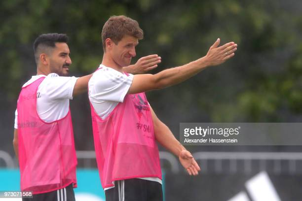 Thomas Mueller reacts with Ilkay Guendogan during the Germany training session ahead of the 2018 FIFA World Cup at CSKA Sports Base on June 13 2018...