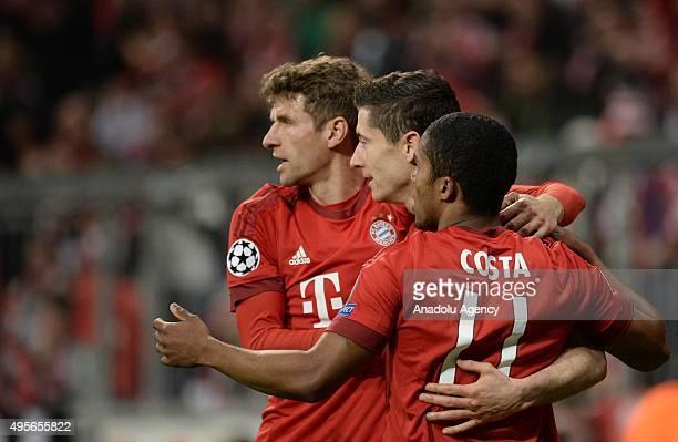 Thomas Mueller Robert Lewandowski and Douglas Costa of Bayern Munich celebrate a goal during the UEFA Champions League group F soccer match between...