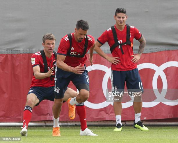 Thomas Mueller Sandro Wagner and James Rodriguez of FC Bayern Muenchen practice during a training session at the club's Saebener Strasse training...
