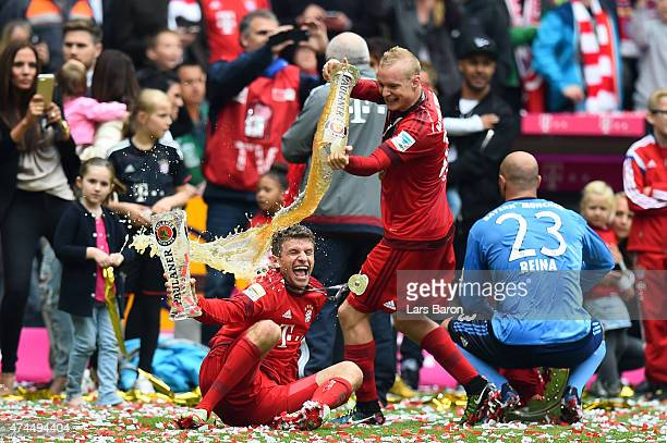 Thomas Mueller Sebastian Rode and Pepe Reina of Bayern Muenchen celebrate after winning the league during the Bundesliga match between FC Bayern...