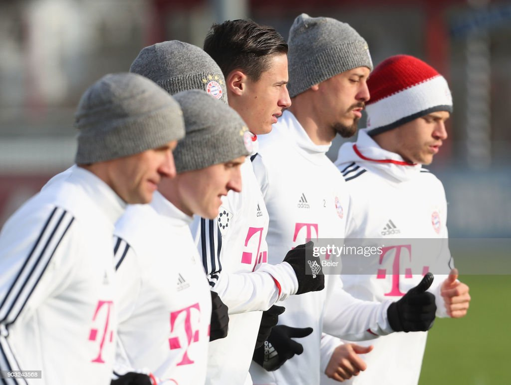 Thomas Mueller, Sebastian Rudy, Marco Friedl, Sandro Wagner and Joshua Kimmich (L-R) of FC Bayern Muenchen warm up during a training session at the club's Saebener Strasse training ground on January 10, 2018 in Munich, Germany.