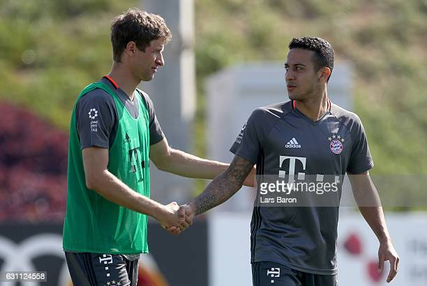 Thomas Mueller shakes hands with Thiago during a training session at day 5 of the Bayern Muenchen training camp at Aspire Academy on January 7 2017...