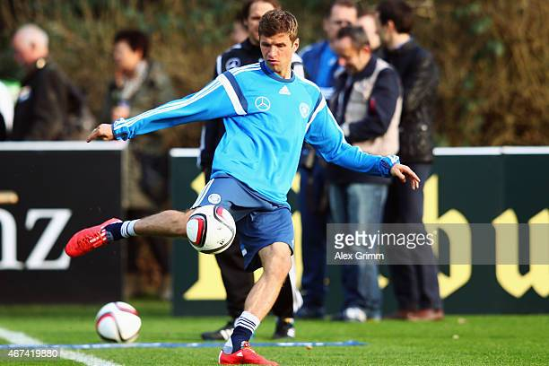 Thomas Mueller shoots the ball during a Germany training session at Kleine Kampfbahn training ground on March 24 2015 in Frankfurt am Main Germany