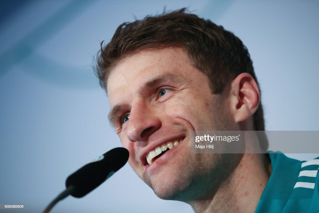 Thomas Mueller smiles during a Germany press conference ahead of their international friendly match against Spain at Hilton Hotel on March 21, 2018 in Duesseldorf, Germany.