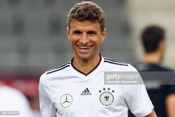 Thomas Mueller smiles during a Germany training session at Eden Arena ahead of their FIFA World Cup Russia 2018 Group C Qualifier against Czech...