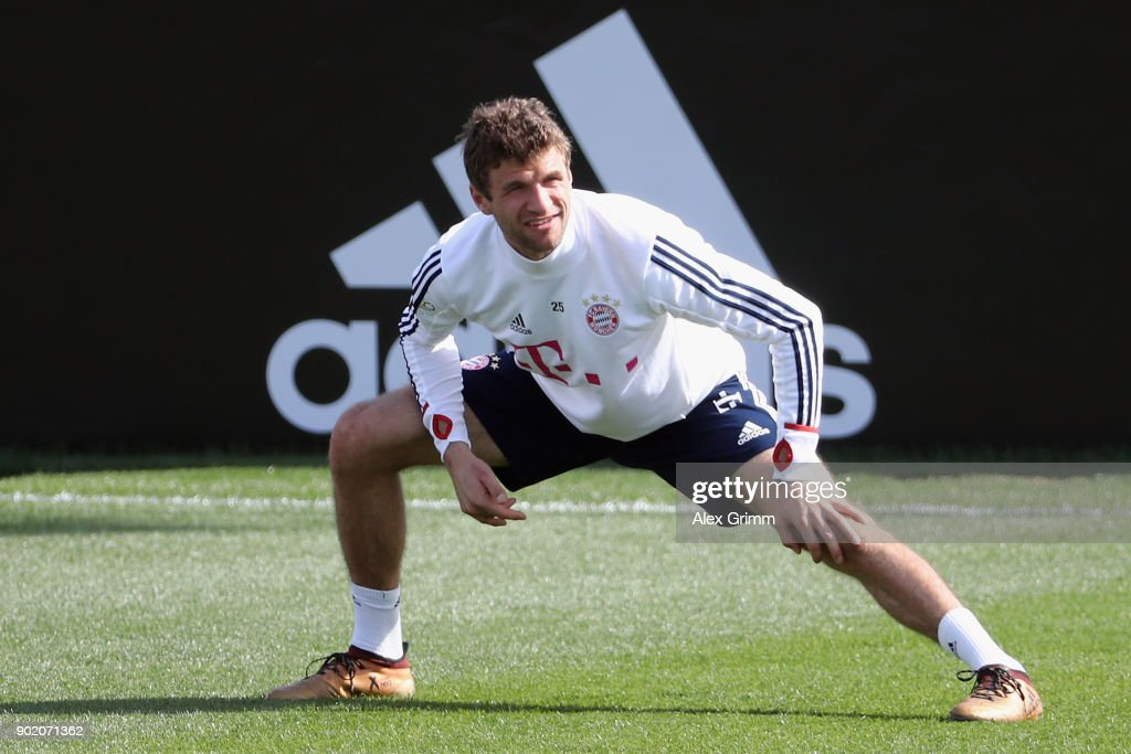 Thomas Mueller stretches during a training session on day 6 of the FC Bayern Muenchen training camp at ASPIRE Academy for Sports Excellence on January 7, 2018 in Doha, Qatar.