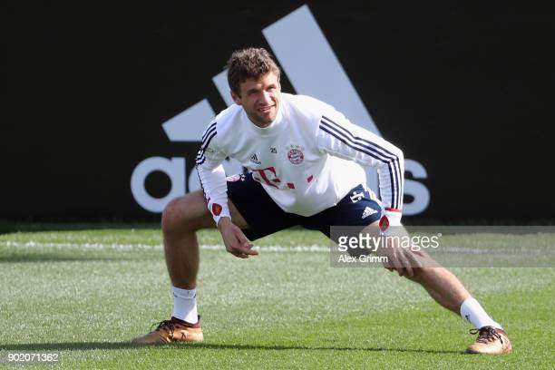 Thomas Mueller stretches during a training session on day 6 of the FC Bayern Muenchen training camp at ASPIRE Academy for Sports Excellence on...