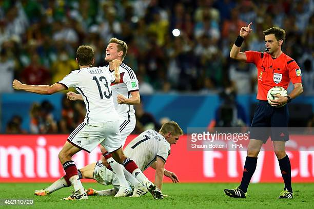 Thomas Mueller , Toni Kroos and Bastian Schweinsteiger of Germany celebrate as referee Nicola Rizzoli blows the final whistle the 2014 FIFA World Cup...