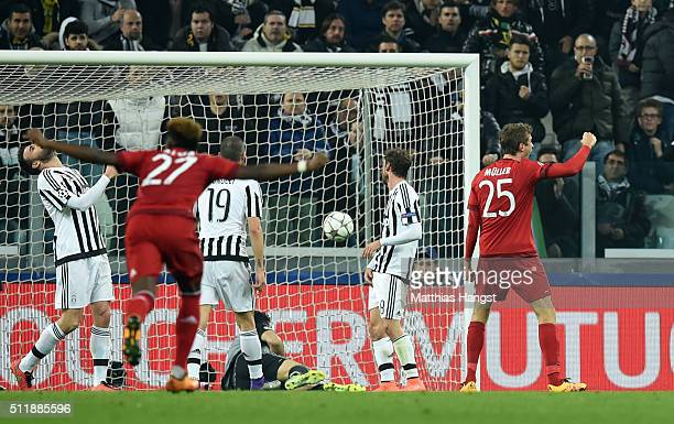 Thomas Muller of Bayern Muenchen celebrates after scoring the opening goal during the UEFA Champions League round of 16 first leg match between...