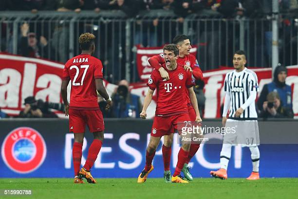 Thomas Muller of Bayern Muenchen celebrates scoring his team's second goal with his team mate Robert Lewandowski during the UEFA Champions League...