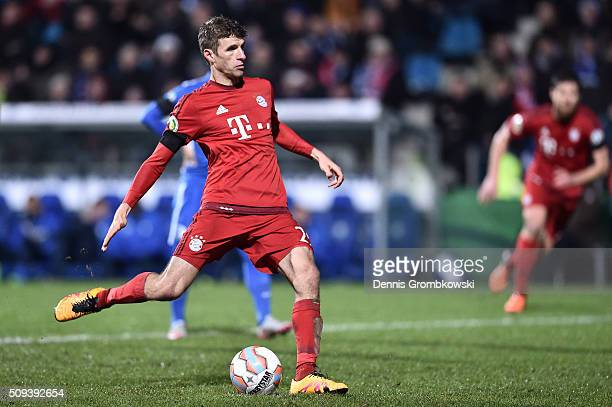 Thomas Muller of Bayern Muenchen has his penalty saved by Manuel Riemann of VfL Bochum during the DFB Cup quarter final match between VfL Bochum and...