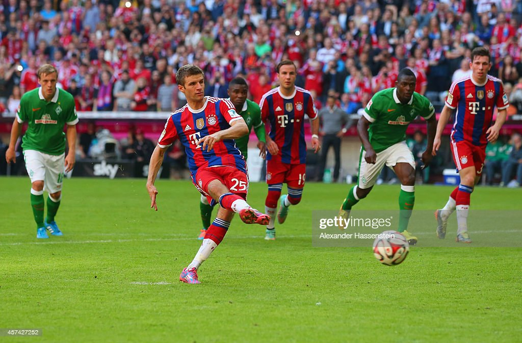 Thomas Muller of Bayern Muenchen scores their third goal from the penalty spot during the Bundesliga match between FC Bayern Muenchen and SV Werder Bremen at Allianz Arena on October 18, 2014 in Munich, Germany.