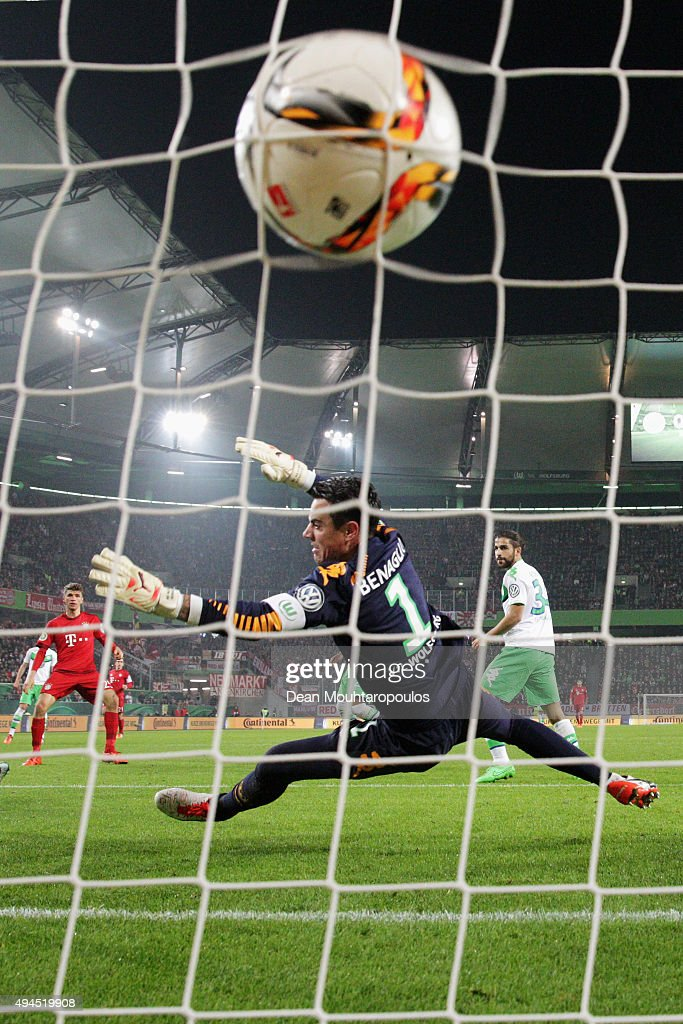 Thomas Muller (C) of Bayern Muenchen shoots and scores his teams second goal of the game past Goalkeeper, Diego Benaglio of VfL Wolfsburg during the DFB Cup match between VfL Wolfsburg and FC Bayern Muenchen at Volkswagen Arena on October 27, 2015 in Wolfsburg, Germany.