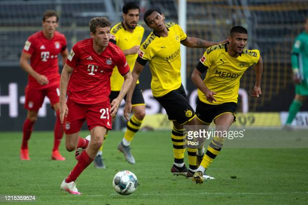 Thomas Muller of Bayern Munich battles for possession with Manuel Obafemi Akanji of Borussia Dortmund during the Bundesliga match between Borussia...
