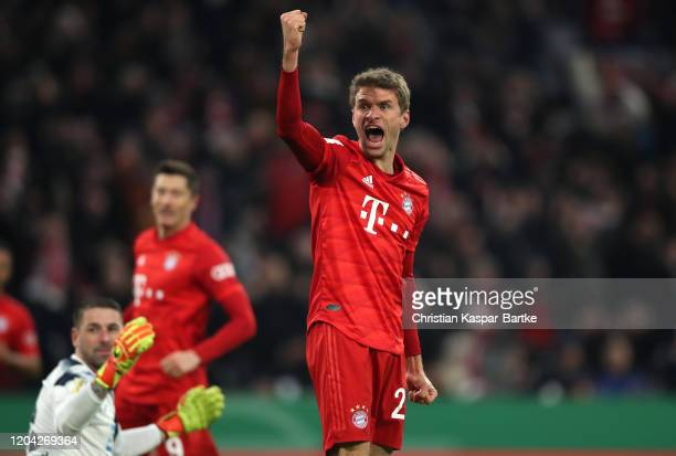 Thomas Muller of Bayern Munich celebrates after Benjamin Huebner of TSG 1899 Hoffenheim scored an own goal which resulted in the first goal for FC...
