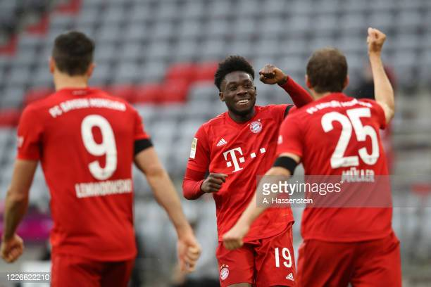 Thomas Muller of Bayern Munich celebrates after he scores his teams second goal with Alphonso Davies of Bayern Munich during the Bundesliga match...