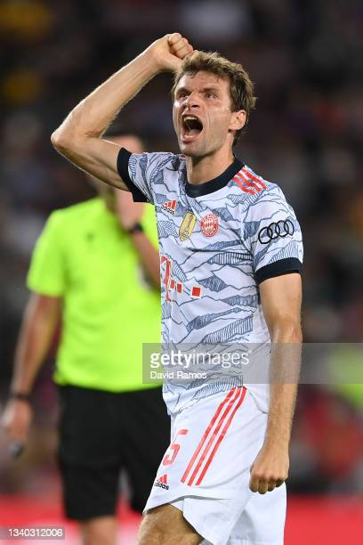 Thomas Muller of Bayern Munich celebrates after scoring their side's first goal during the UEFA Champions League group E match between FC Barcelona...