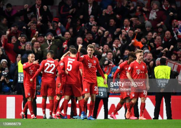 Thomas Muller of Bayern Munich celebrates his sides first goal scored by Serge Gnabry during the UEFA Champions League round of 16 first leg match...