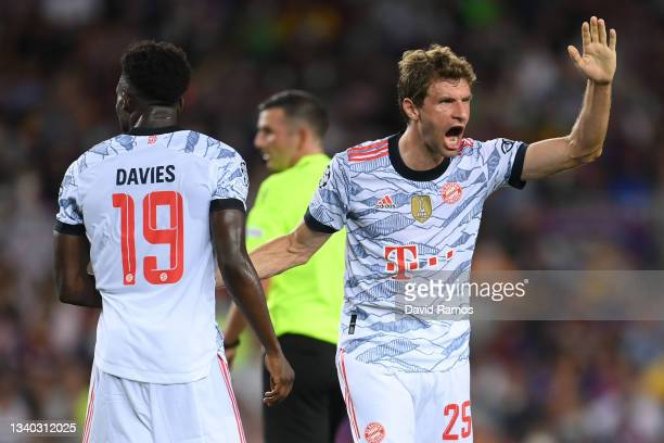 Thomas Muller of Bayern Munich celebrates with teammate Alphonso Davies after scoring their side's first goal during the UEFA Champions League group...