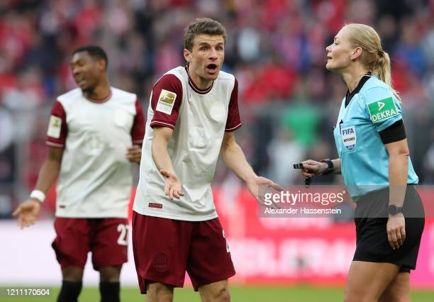 Thomas Muller of Bayern Munich complains to referee Bibiana Steinhaus during the Bundesliga match between FC Bayern Muenchen and FC Augsburg at...
