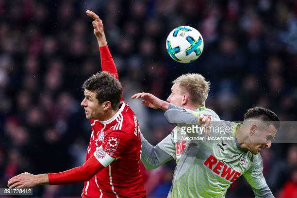 Thomas Muller of Bayern Munich Frederik Sorensen of 1FC Koeln and Pawel Olkowski of 1FC Koeln the Bundesliga match between FC Bayern Muenchen and 1...