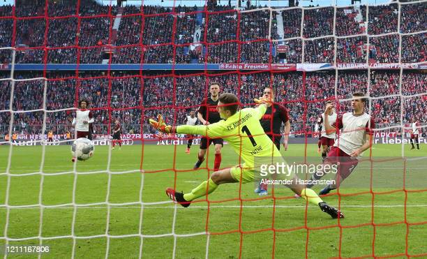 Thomas Muller of Bayern Munich scores his team's first goal during the Bundesliga match between FC Bayern Muenchen and FC Augsburg at Allianz Arena...