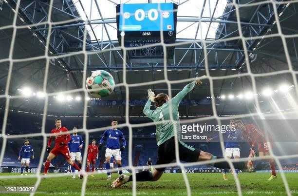 Thomas Muller of Bayern Munich scores their sides first goal past Ralf Fahrmann of FC Schalke 04 during the Bundesliga match between FC Schalke 04...