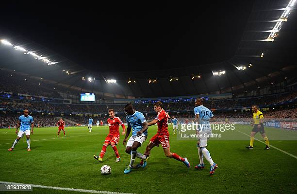 Thomas Muller of FC Bayern Muenchen battles with Micah Richards of Manchester City during the UEFA Champions League Group D match between Manchester...