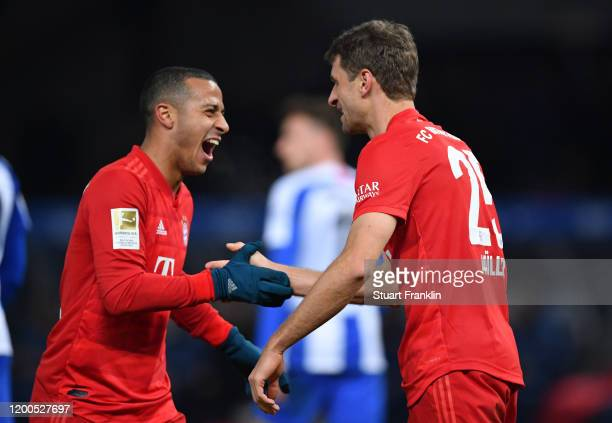 Thomas Muller of FC Bayern Muenchen celebrates after scoring his sides first goal during the Bundesliga match between Hertha BSC and FC Bayern...
