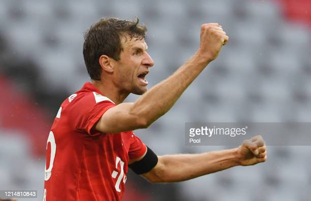 Thomas Muller of FC Bayern Muenchen celebrates after scoring his team's second goal during the Bundesliga match between FC Bayern Muenchen and...