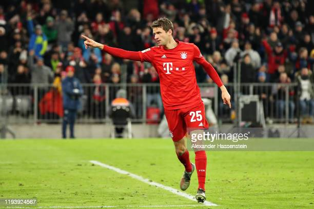 Thomas Muller of FC Bayern Muenchen celebrates scoring his sides fifth goal during the Bundesliga match between FC Bayern Muenchen and SV Werder...