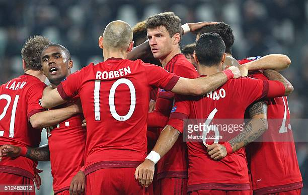 Thomas Muller of FC Bayern Muenchen celebrates with his teammates after scoring the opening goal during the UEFA Champions League Round of 16 first...