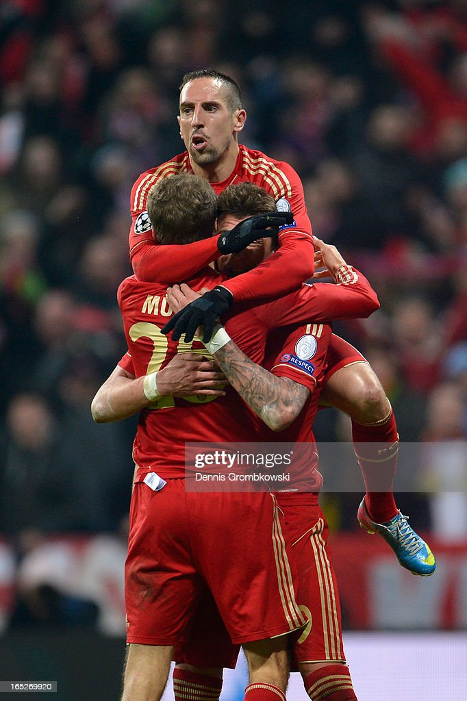 Thomas Muller #25 of FC Bayern Muenchen celebrates with teammates Franck Ribery and Mario Mandzukic after scoring his team's second goal during the UEFA Champions League quarter final first leg match between FC Bayern Muenchen and Juventus at Allianz Arena on April 2, 2013 in Munich, Germany.