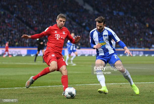 Thomas Muller of FC Bayern Muenchen is tackled by Marvin Plattenhardt of Hertha Berlin during the Bundesliga match between Hertha BSC and FC Bayern...