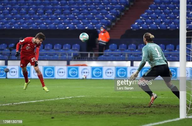 Thomas Muller of FC Bayern Muenchen scores their side's first goal past Ralf Fahrmann of FC Schalke 04 during the Bundesliga match between FC Schalke...