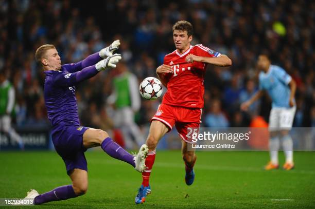 Thomas Muller of FC Bayern Munchen scores the second goal past Joe Hart of Manchester City during the UEFA Champions League Group D match between...