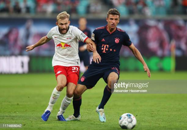 Thomas Muller of FC Bayern Munich and Konrad Laimer of RB Leipzig battle for the ball during the Bundesliga match between RB Leipzig and FC Bayern...