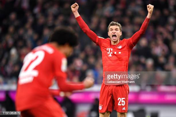 Thomas Muller of FC Bayern Munich celebrates after scoring his team's first goal during the Bundesliga match between FC Bayern Muenchen and Bayer 04...