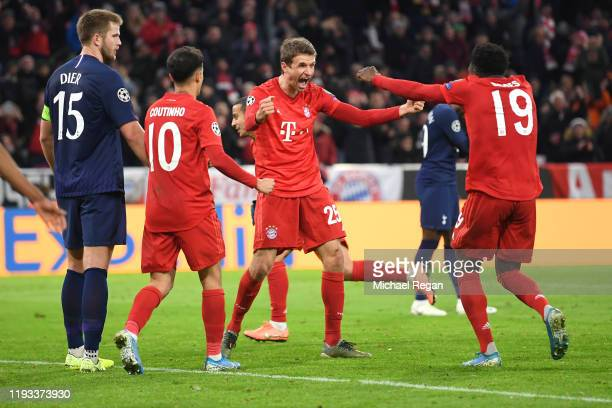 Thomas Muller of FC Bayern Munich celebrates after scoring his team's second goal with Alphonso Davies during the UEFA Champions League group B match...