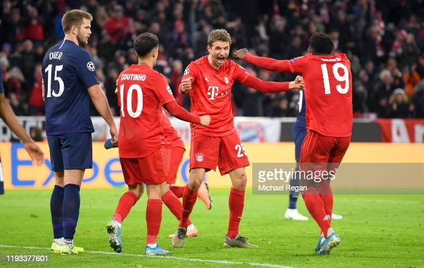 Thomas Muller of FC Bayern Munich celebrates after scoring his team's second goal with Philippe Coutinho and Alphonso Davies during the UEFA...