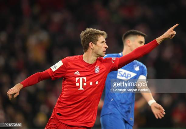 Thomas Muller of FC Bayern Munich celebrates after scoring his team's second goal during the DFB Cup round of sixteen match between FC Bayern...