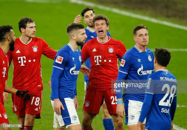Thomas Muller of FC Bayern Munich celebrates after scoring their side's third goal during the Bundesliga match between FC Schalke 04 and FC Bayern...