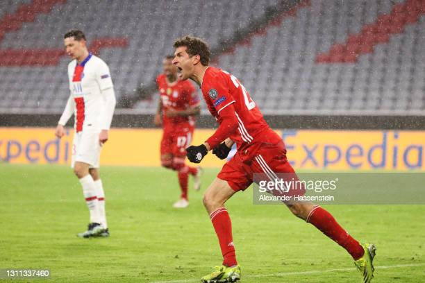Thomas Muller of FC Bayern Munich celebrates after scoring their side's second goal during the UEFA Champions League Quarter Final match between FC...