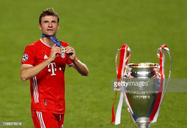 Thomas Muller of FC Bayern Munich celebrates with his winners medal following the UEFA Champions League Final match between Paris Saint-Germain and...
