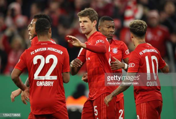 Thomas Muller of FC Bayern Munich celebrates with teammates after scoring his team's second goal during the DFB Cup round of sixteen match between FC...